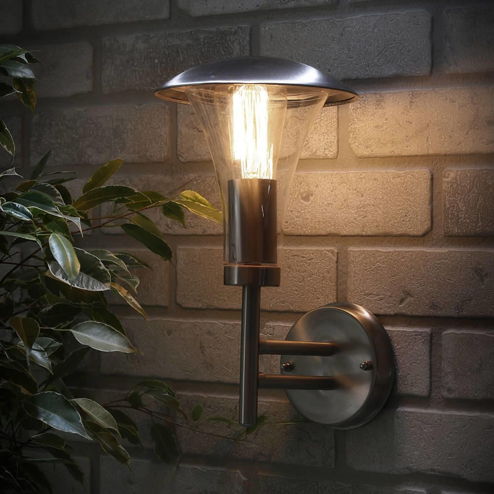 Ouse outdoor fluted wall light stainless steel from litecraft exterior wall light lifestyle against brick wall night time aloadofball Image collections