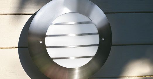 Brushed Stainless Steel Outdoor Bulkhead Wall Light on Wooden Slatted Fence